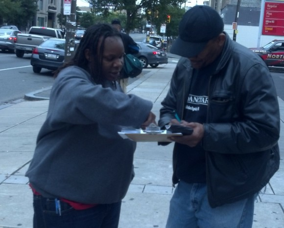 Bain worker Shantees Johnson registers a Philadelphian to vote